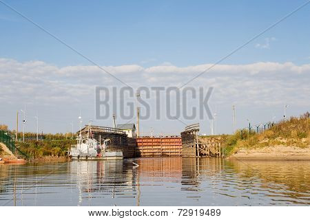 Old Sluice On The River. Moored Boat. The North Of Russia