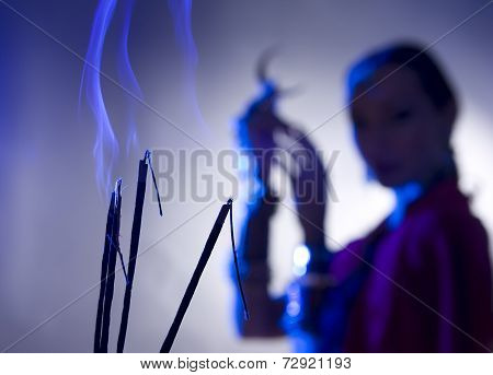 Beautiful Indian Woman Silhouette With Incense Holding A Moon Symbol (blurred Background), Spiritual