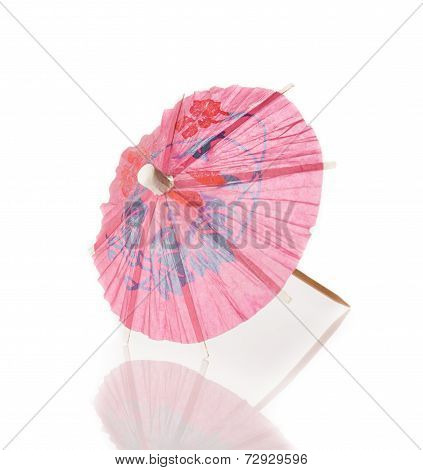 Pink Cocktail Umbrella Isolated Against White Background