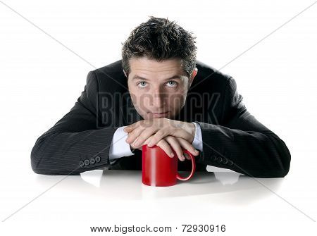 Young  Attractive Business Man In Suit Sitting With Red Mug Or Cup Of Coffee