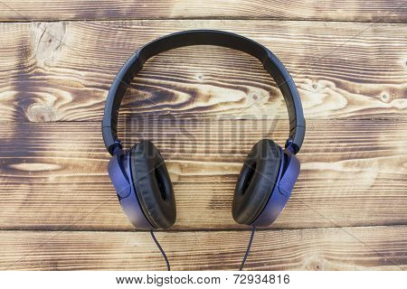Earphones on a wooden background