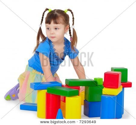 Little Girl Is Playing With Color Bricks