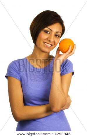 Young Ethnic Woman Holds An Orange.