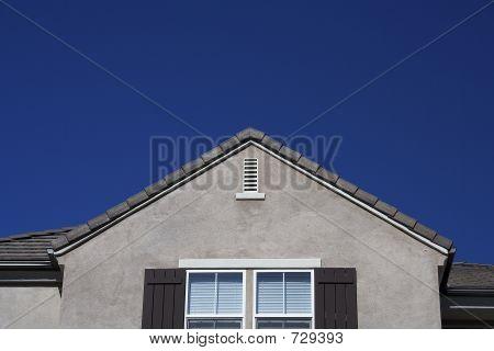 House With Blue Sky