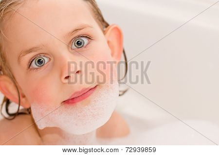 Pretty Little Girl Playing In The Bathtub