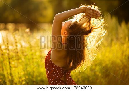 Woman With Her Hair In The Evening Sun