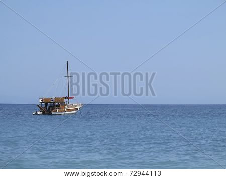 Old Wooden Fishing Boat Trawler Over Calm Blue Sea