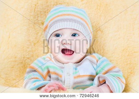 Happy Little Baby Relaxing In A Warm Sheepskin Stroller Foot Muff