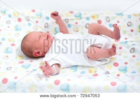 Tiny Newborn Baby On A Changing Table