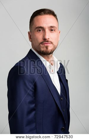 Portrait Of Man With Facial Hair Wearing Suit