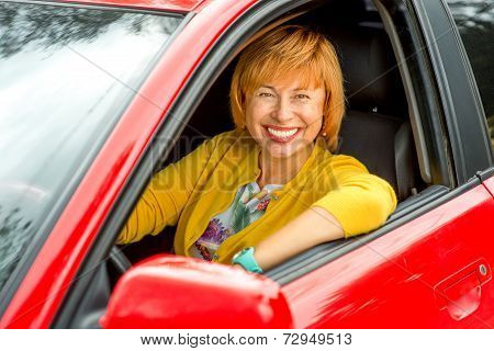 Portrait of older woman driving a car