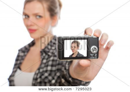 Blonde Girl Taking A Photo Of Herself With A Digital Camera