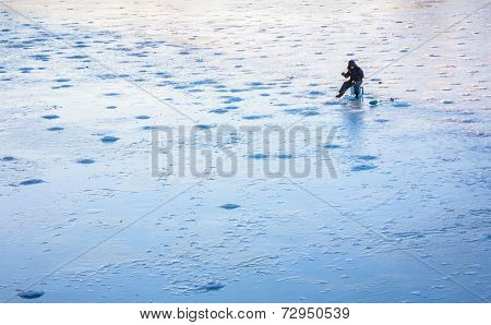 Ice Fishing On Frost Lake In Winter Time
