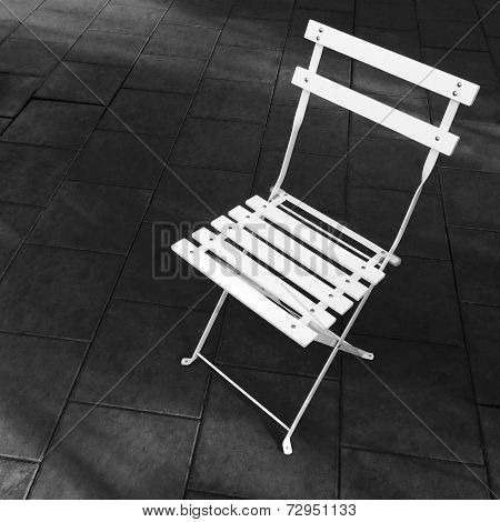 White Foldable Chair On Dark Background