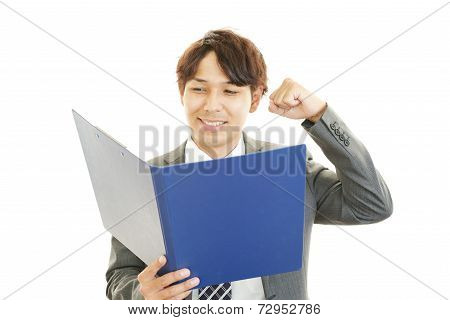 Smiling Asian businessman