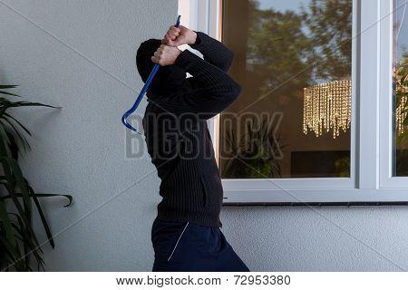 Burglar Breaks The Window