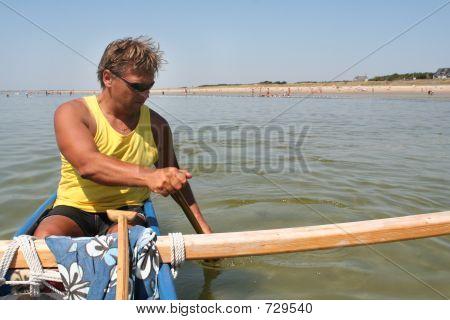 man in pirogue