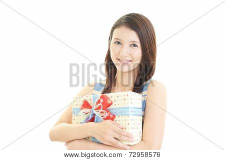 The woman who smiles with a present