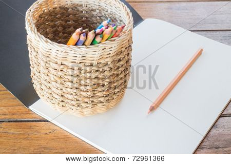 Art Paper Book And Many Different Colored Pencils