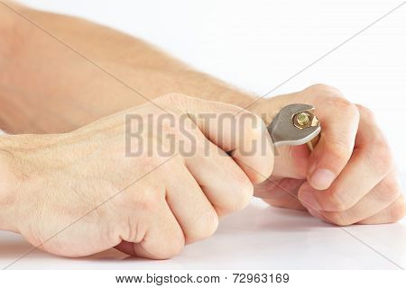 Hand of serviceman with a wrench to tighten the nut on white background