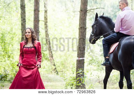 Man On Horse And Girl
