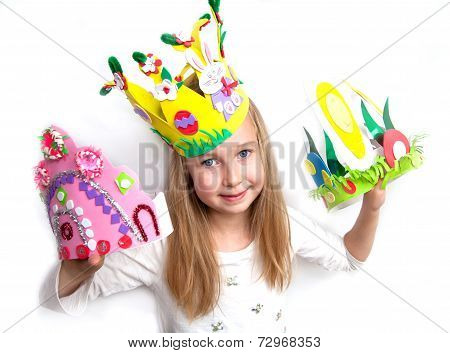 Little girl demonstrating her cruft work Easter bonnets