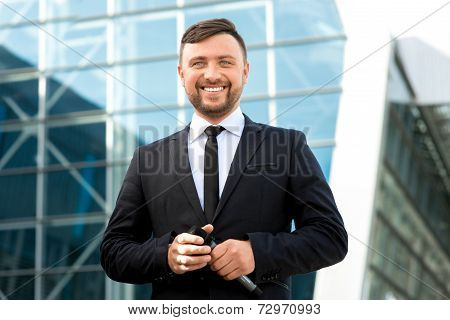 Portrait Of Well-dressed Man On The Contempopary Background