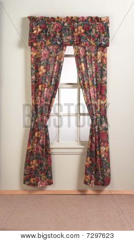 floral curtains hang on home window