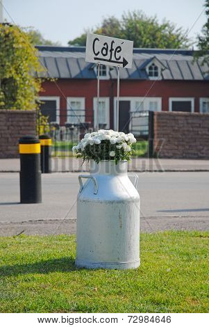 Flowers In Milk Churn