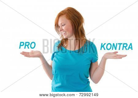Young girl smiling with pro and contra signs isolated on white.
