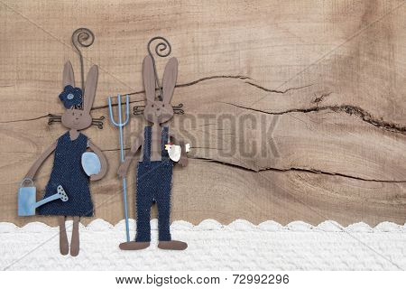 Easter decoration with two rabbits on a wooden background