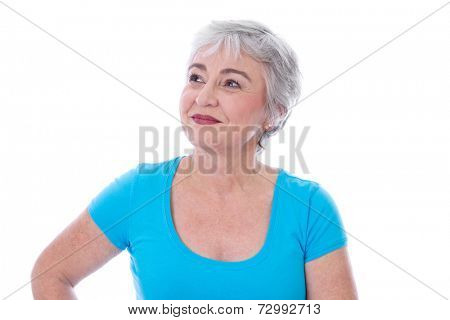 Portrait of happy senior woman looking up