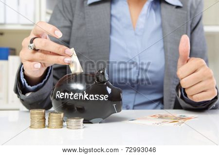 Hands of woman paying money for pension fund
