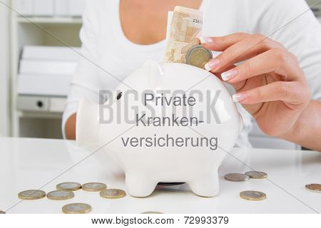 Piggy bank with money saving on private medical insurance