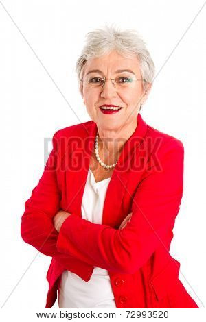 Happy senior businesswoman standing with arms crossed