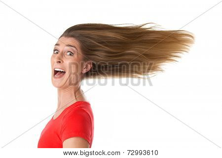 Funny portrait of young woman with flowing hair