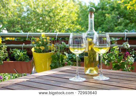 White wine served for two in garden.