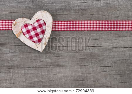 Top view of checked  heart decoration on wooden background for valentine, mother's day, wedding or birthday or just to say thank you