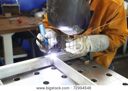 Close up of craftsman welding