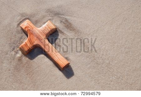 Close up of wood carved cross on beach