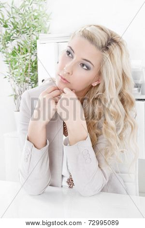Caucasian woman sitting and wondering