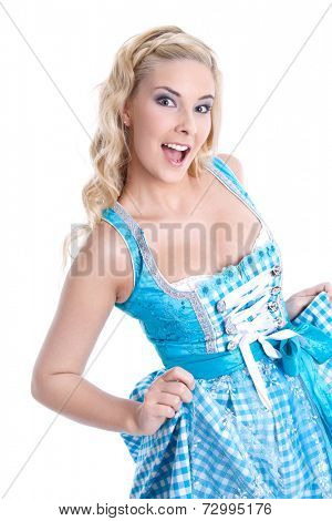 Studio shot of isolated young bavarian woman wearing dirndl and posing