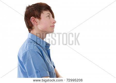 Side view of young boy looking up