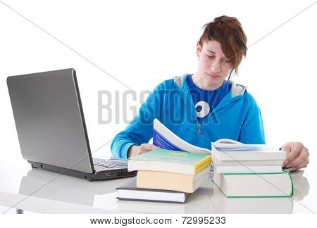 Teenager boy studying and reading book