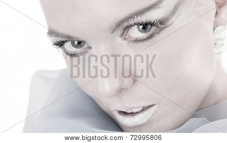 Cloes up of woman with frosty makeup