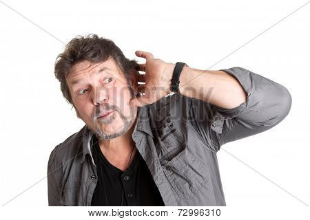 Caucasian man listening to gossip - pensioner isolated over white.