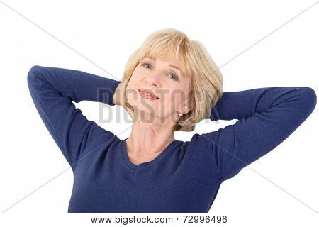 Happy senior woman sitting and massaging her nape, isolated on white background