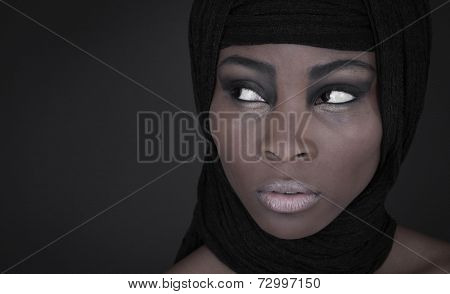 Portrait of young African American woman wearing black shawl