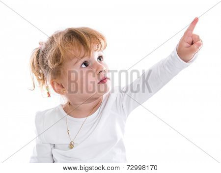Young girl looking and pointing up at corner on white background .