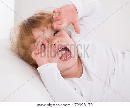 Face: young girl playing around on white background .